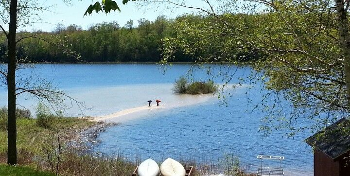 Kids writing their names on a sand bar at Hulbert Lake in the u.p.