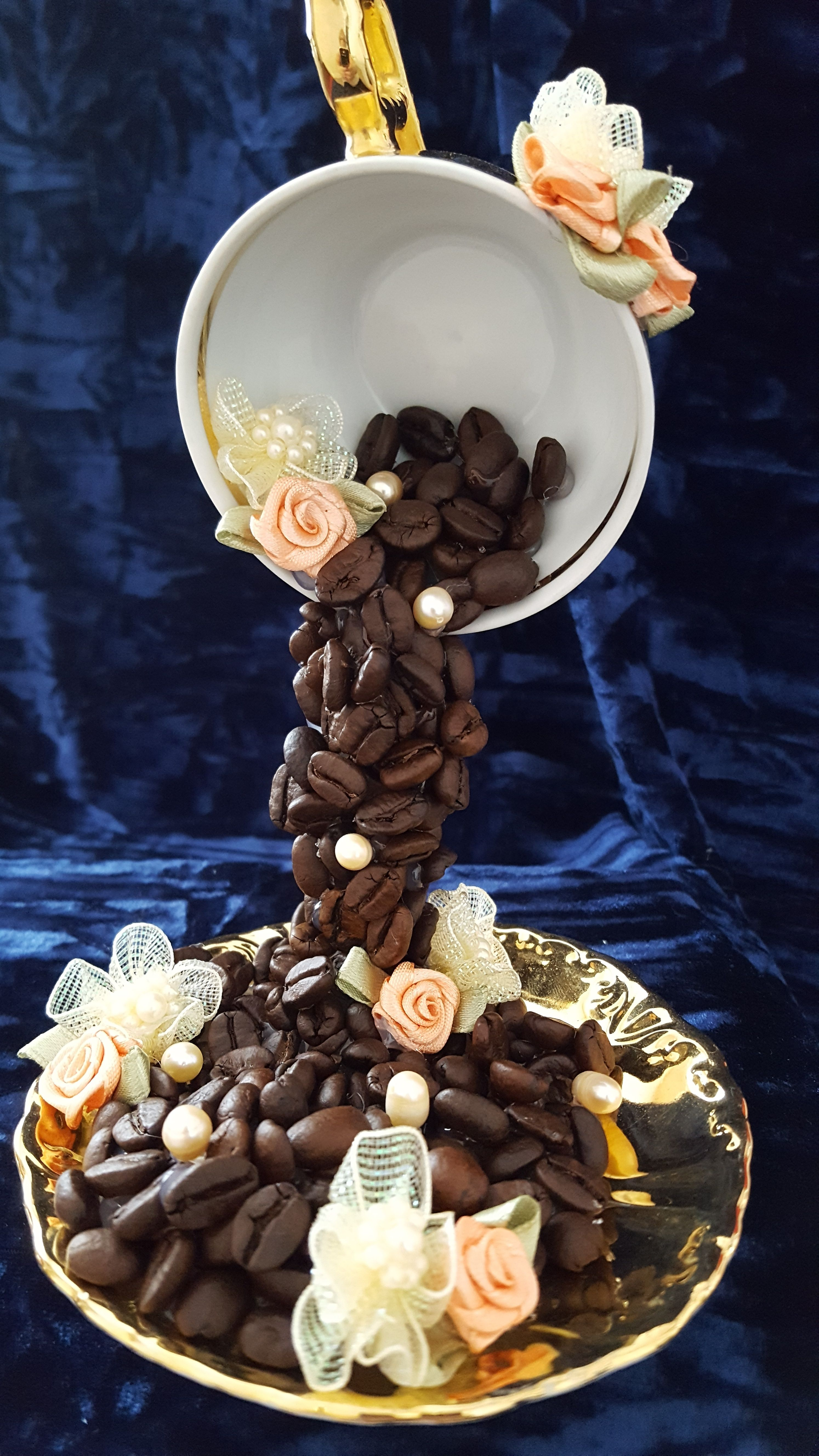 Floating Cup with Coffee Beans. Made by Maria Hibbard