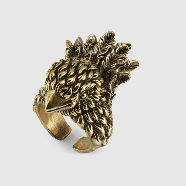 db2613f4e8 Made in metal with aged gold finish, this Gucci bird ring has ...