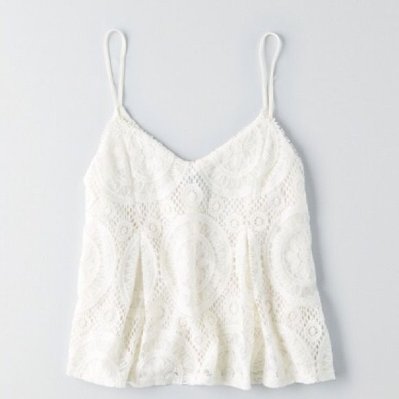 Lace embroidered white tank Flowy white tank with spaghetti straps, gorgeous embroidery! Great condition  Offers gladly accepted!  Great bundle discounts!  Trading ✅ Thanks for looking!  American Eagle Outfitters Tops Tank Tops
