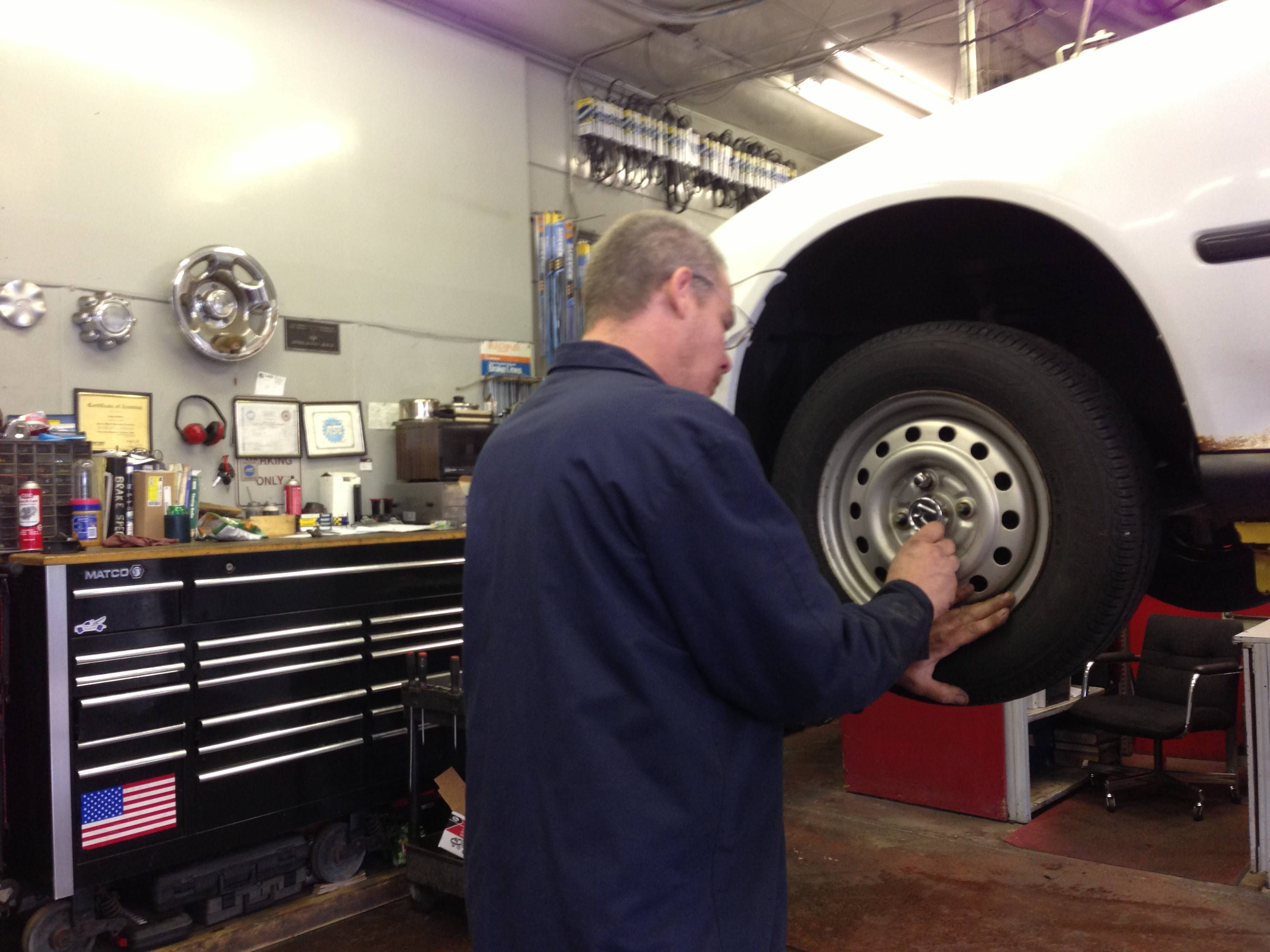 Our ase certified mechanic james working on a tire winnetka our ase certified mechanic james working on a tire xflitez Image collections