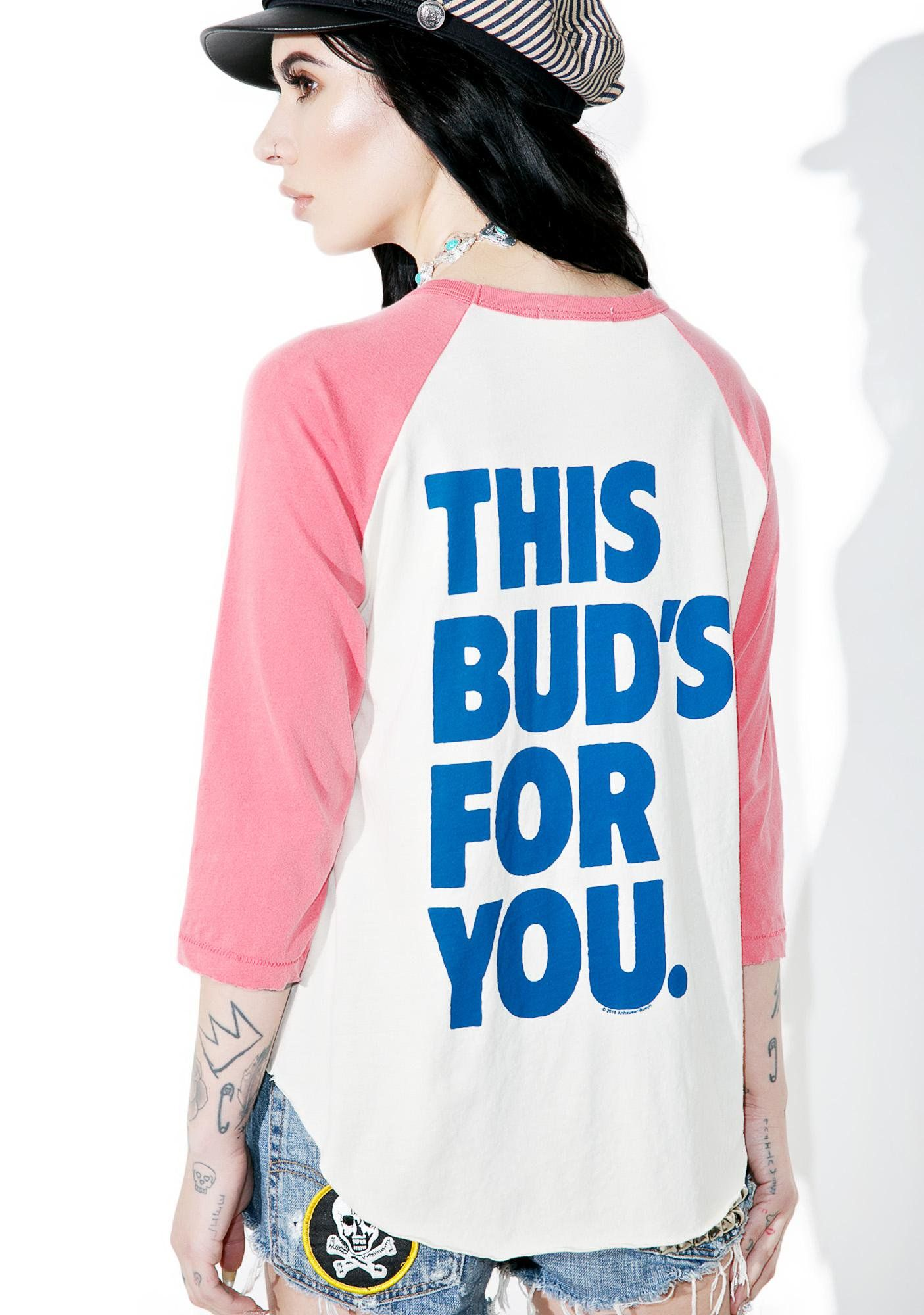 """Junk Food Clothing Budweiser Raglan Tee is yer favorite type of bud to pass around, bb. This raglan long sleeve features a relaxed fit, contrasting red quarter sleeves, a raw hem, logo design on the front, and large text that reads """"this buds for you"""" on the back."""