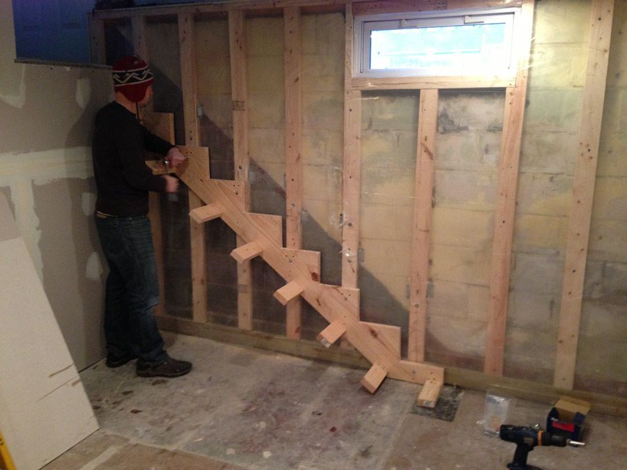 Floating stair stringer support braces screwed to stringer for How to build floating walls in basement