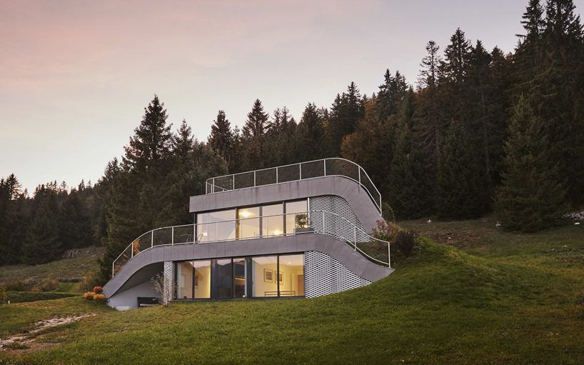 Swooping French Home Is Partially Built Into A Hillside French