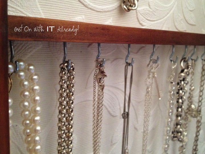Simple but effective way of storing necklaces - for the dressing room.  Spare bit of