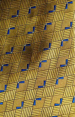 """This 100% silk necktie designed by Geoffrey Beene has mini cobalt blue """"birdlike"""" designs over a bright yellow geometric squares perfectly designed put you on The Best Dressed list.  When you wear it, prepare for compliments!"""