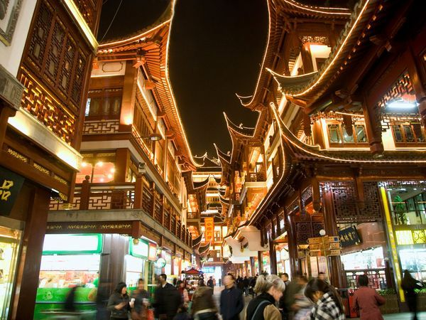 Yu Yuan Teahouses, Shanghai - Near the elaborate Chenghuang, or City God, Temple in Shanghai are the famous Yu Yuan Bazaar and Gardens. Teahouses line the main street, where tourists flock each morning to buy calligraphy, pearls, and antiques. - Photograph by Grant Faint, Getty Images