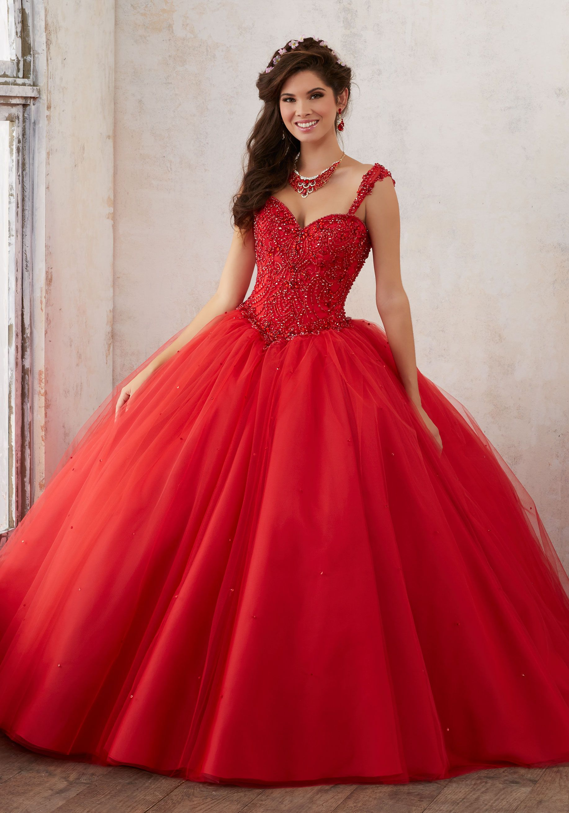 Jeweled beading on a tulle quinceañera ball gown valencia style