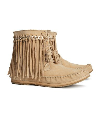 Suede ankle boots with metal chain and fringe trim at top