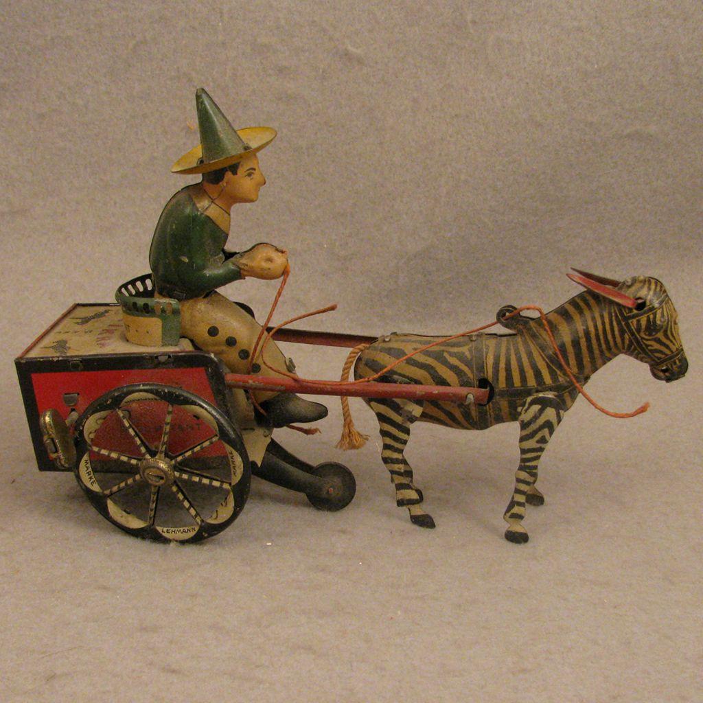 c.1925 Lehmann Zikra Tin Wind up Toy Man on Cart w/ Zebra