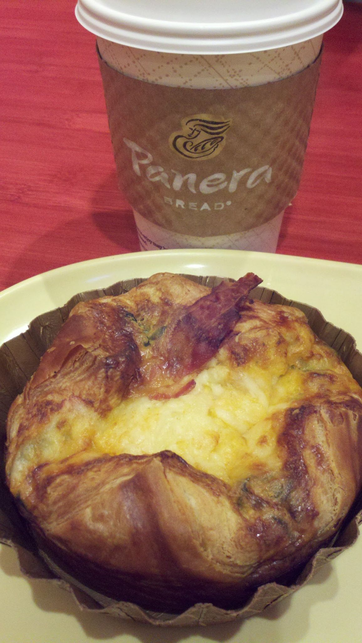 A spinach and bacon soufflé with hazelnut coffee at @PaneraBread.  The coffee was free as reward for frequent use of #MyPanera card!