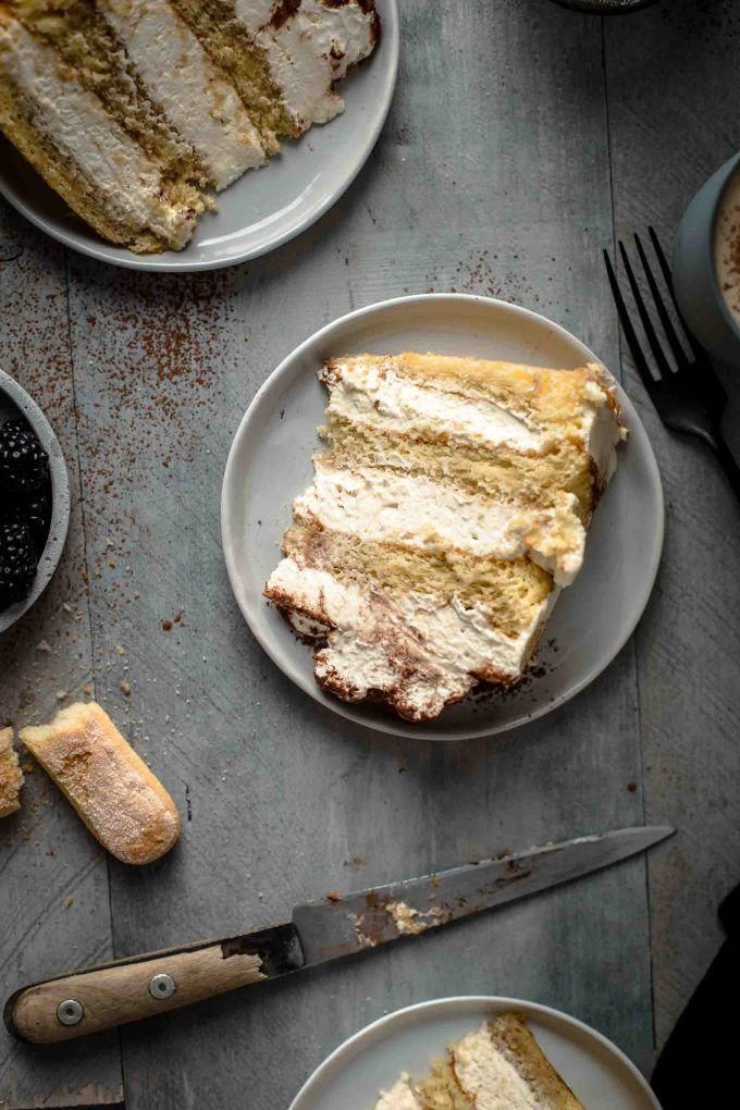 This super delicious Tiramisu Cake recipe comes with detailed step-by-step photos and video. Tiramisu Cake Recipe by Also The Crumbs Please