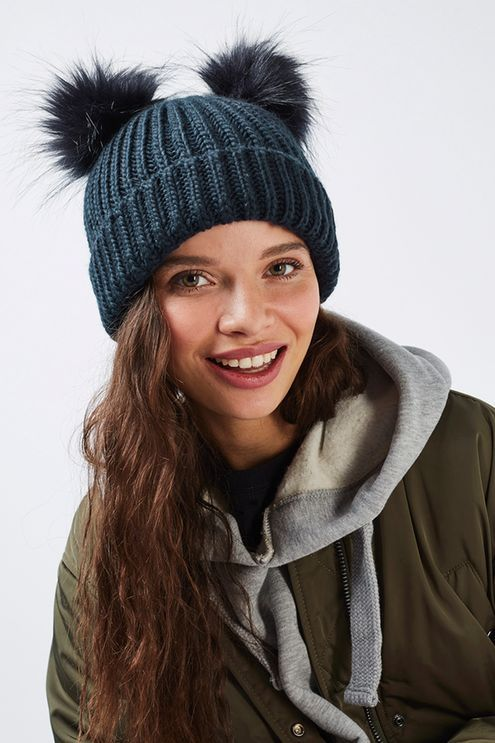 e58169abfb5 Why settle for one pom-pom when you can have two  This cute ribbed beanie  comes in a navy blue with double pom detail to the top.  Topshop