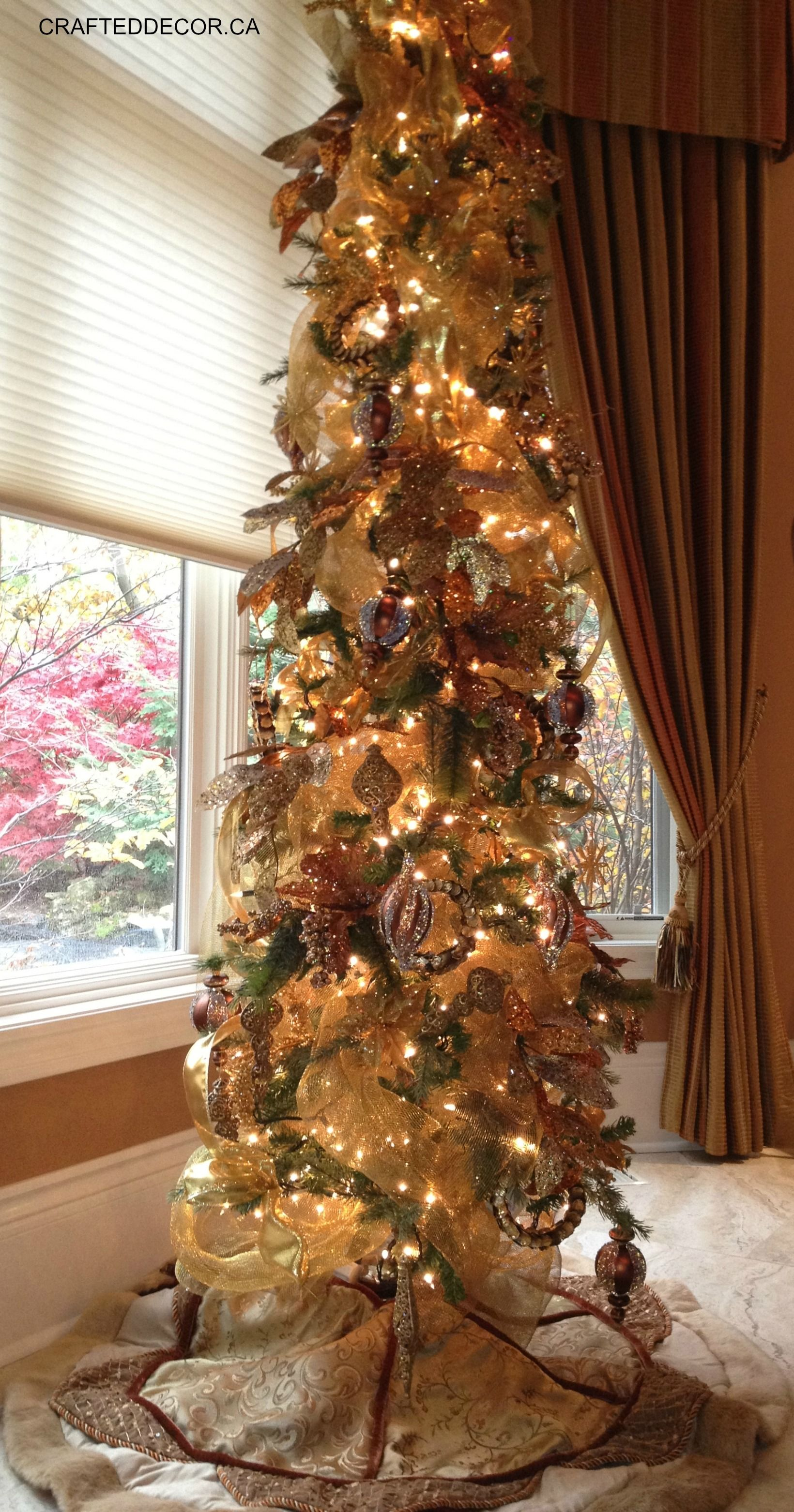 Slim trees in any corner or window add sparkle ...