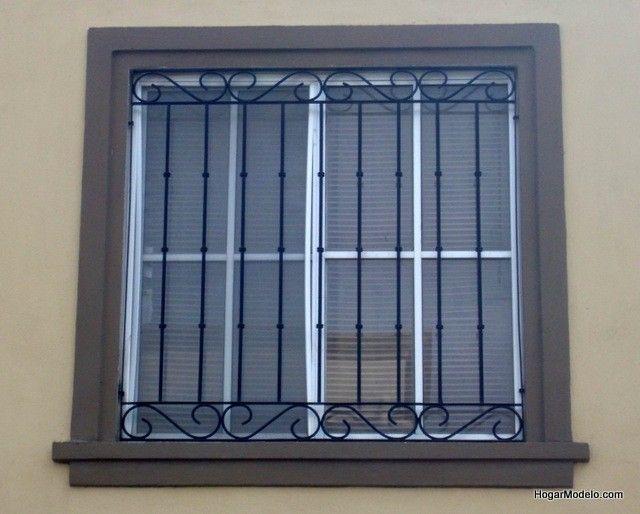 Rejas de hierro instaladas como protecci n de ventanas con un dise o de herrer a art stica Rejas de diseno