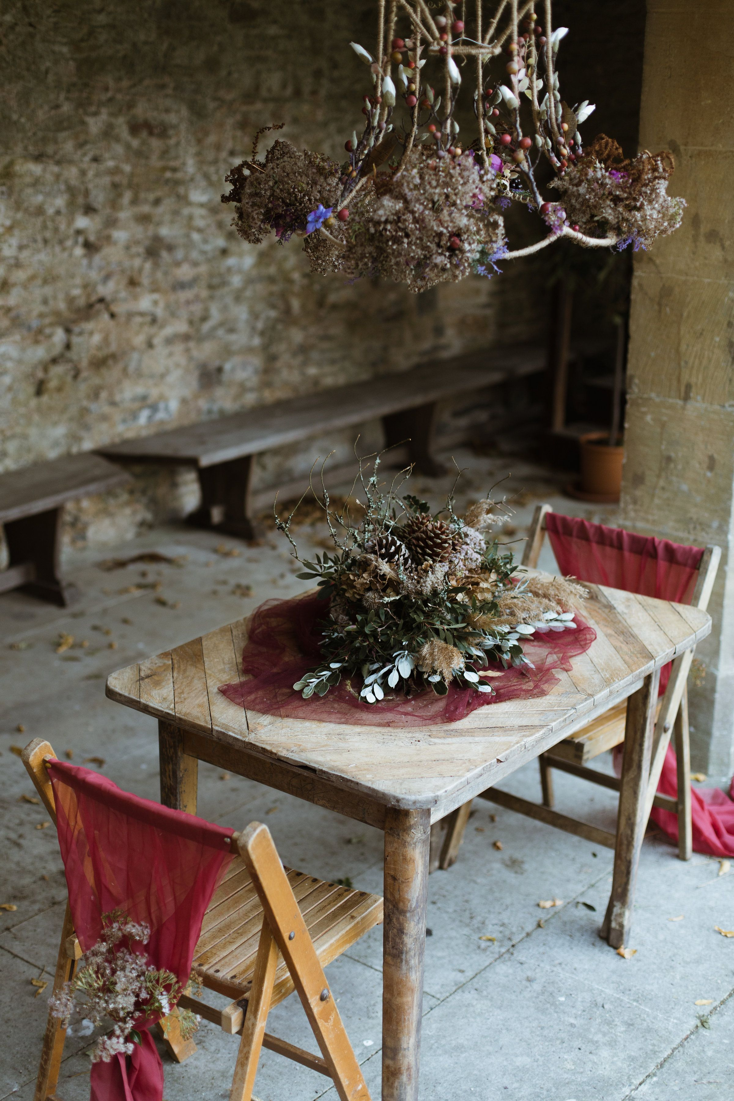Fall wedding decor ideas  Moss and woodland foliage lampshade above a rustic table Rustic
