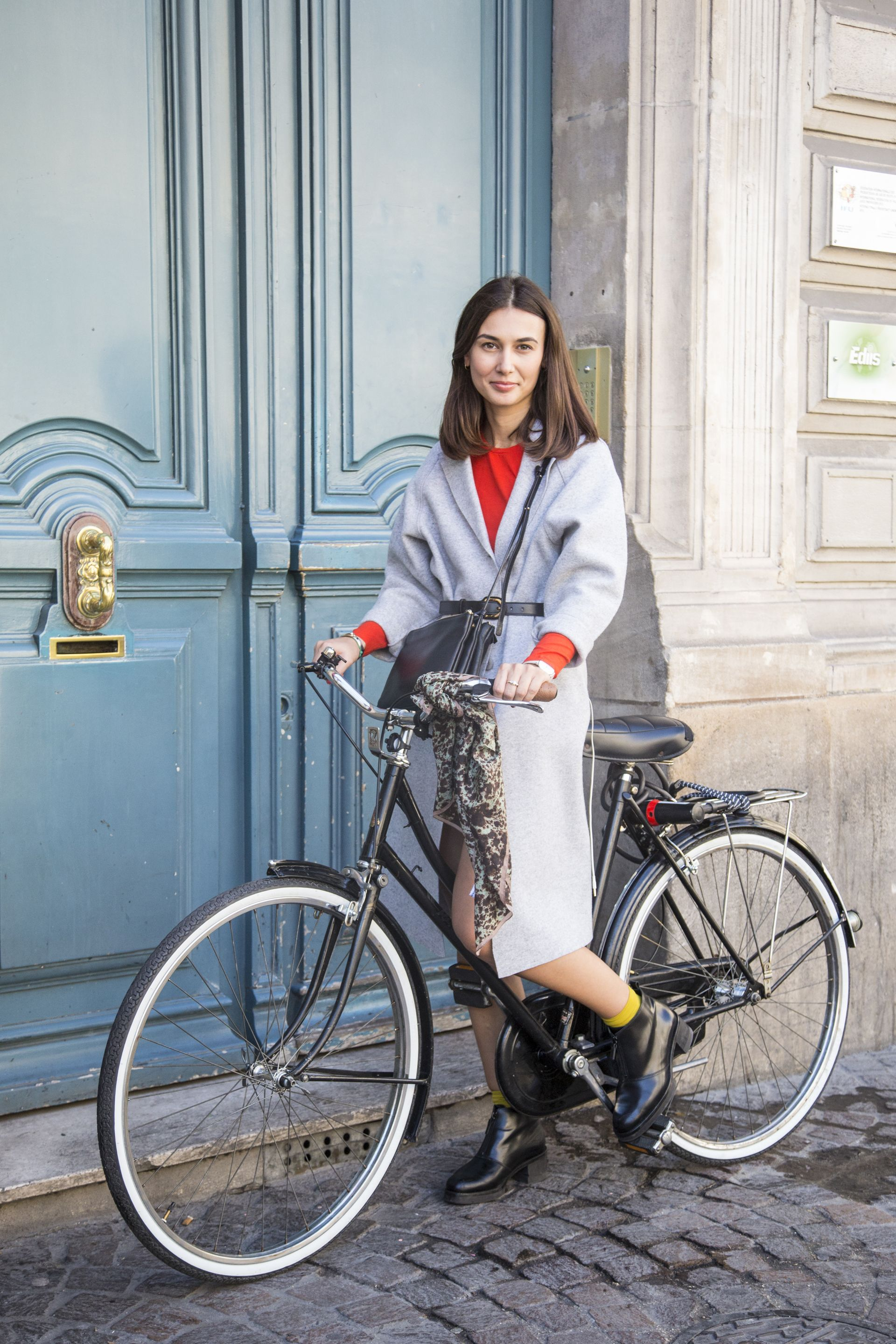 10 Impossibly Chic Parisian Women On Bikes To Remind You That You