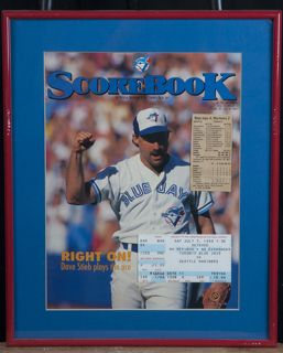 FRAMED SCOREBOARD MAGAZINE COVER OF THE BLUE JAYS AND ALSO COMES WITH A TICKET STUB. MEASURES 11 X 14.