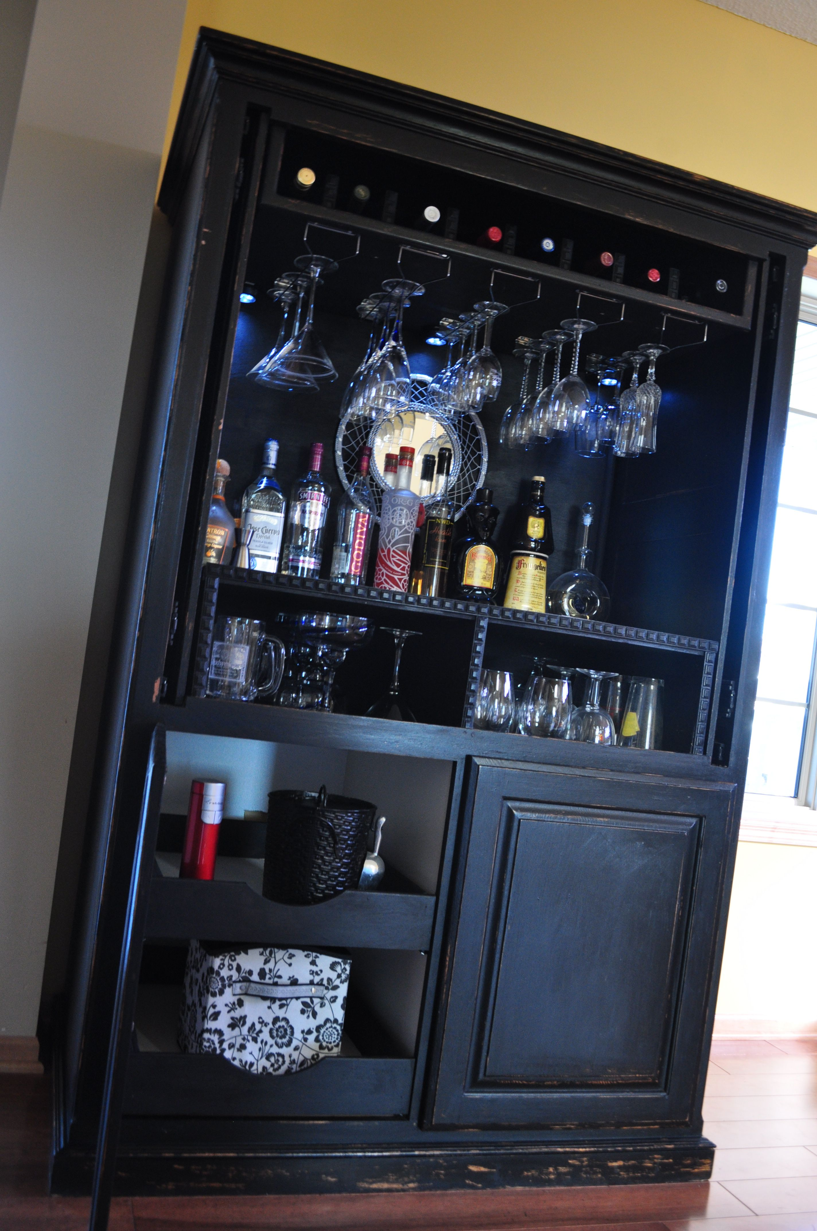 Repurposed Entertainment center into a bar! Check us out on facebook ...
