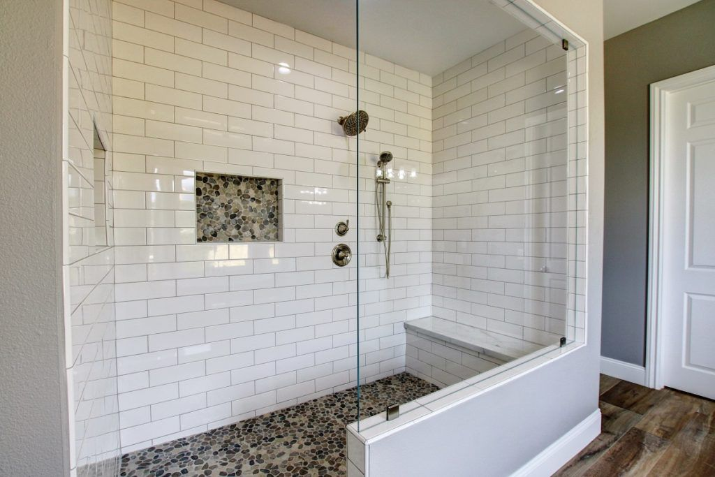 Huge Walk In Shower With White Subway Tile And Pebble Mosaic Flooring And Backsplash Master Bat Bathroom Remodel Shower Pebble Shower Floor Shower Remodel