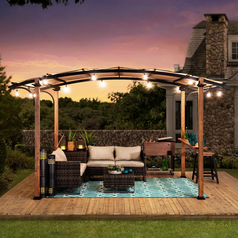 Sunjoy Alamo 10 Ft X 7 5 Ft Steel Arched Pergola With Natural Wood Looking And Tan Shade 169391 The Home Depot In 2020 Pergola Grill Gazebo Backyard Pavilion
