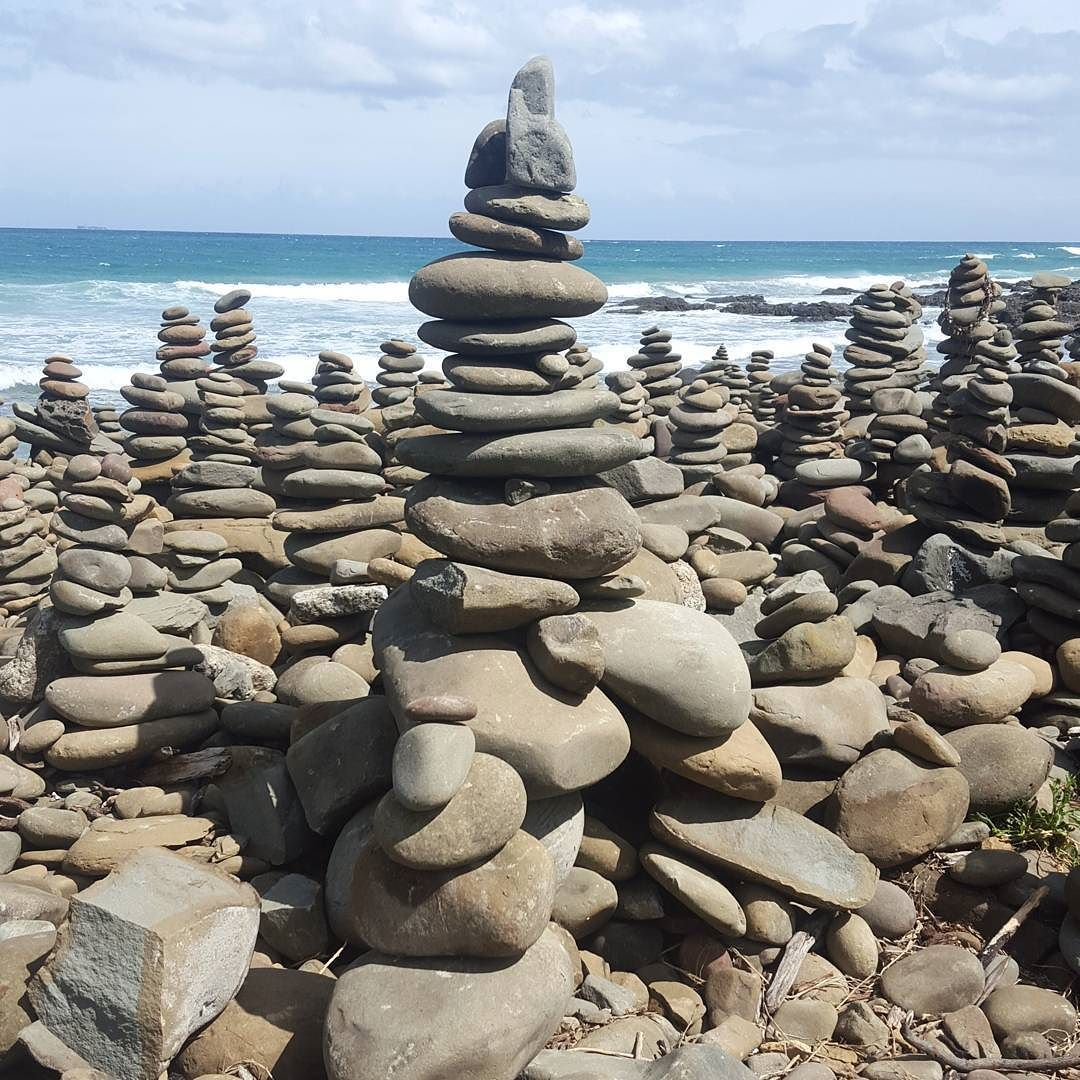 These incredible rock piles covered the sand at Carisbrook Creek. Pretty amazing! #greatoceanroad #carisbrook #art #beach #holiday by amyzingification