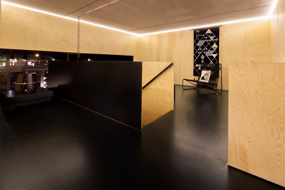 Hidden Fortress | Design Studio Berlin. Interior Design for Bazar Noir, a concept store for selected goods. The upper floor is accessible over a floating staircase.