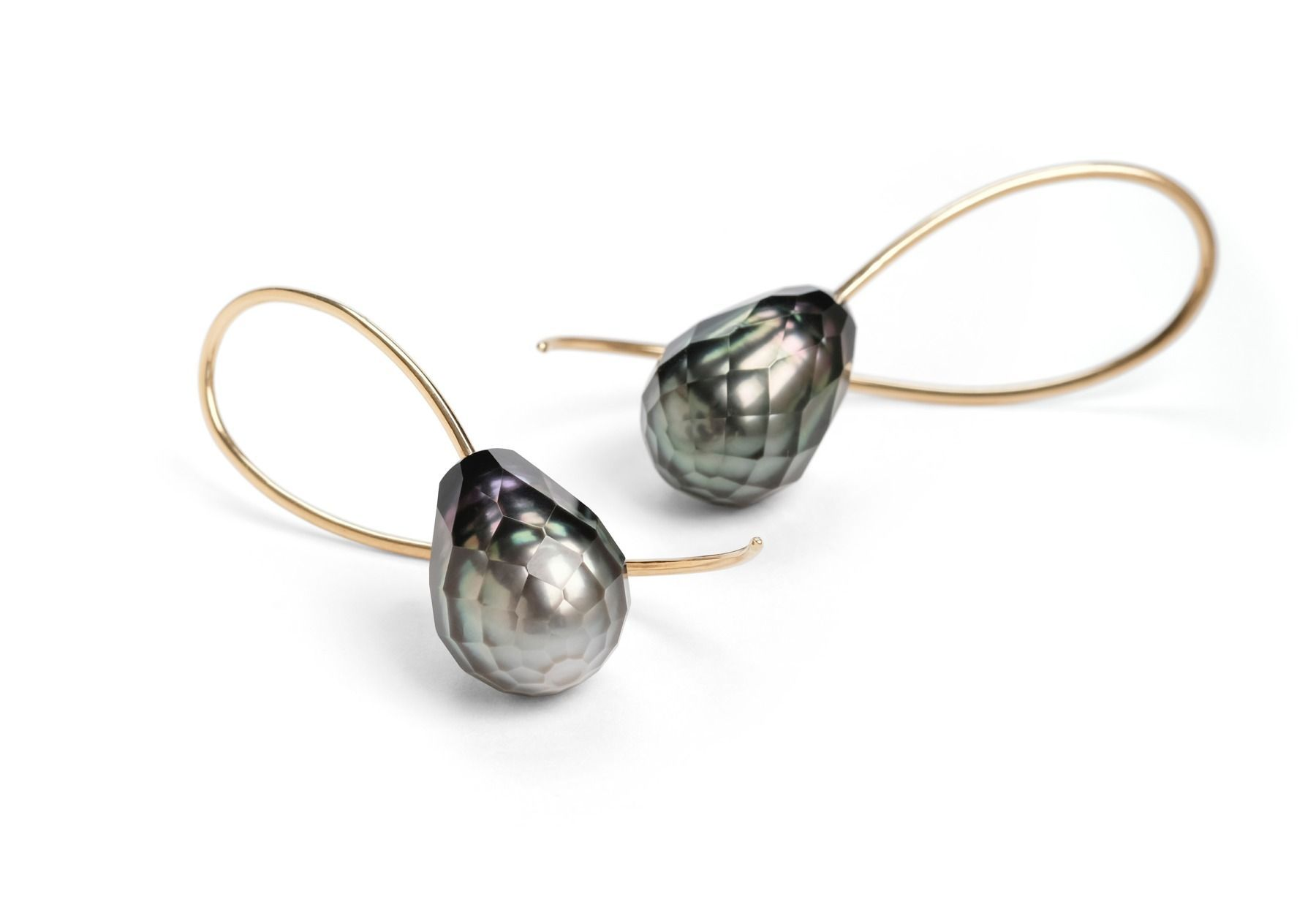 bdf67234688 Our faceted pearl drop earrings feature South Sea and Tahitian pearls  suspended on seemingly delicate wires