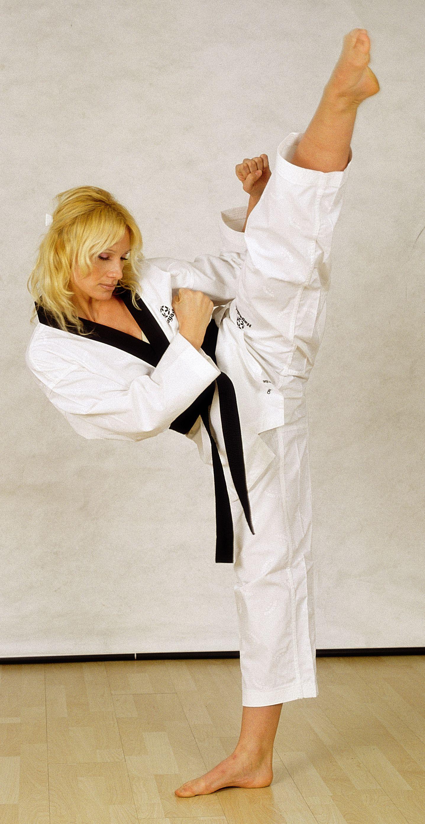Portrait Of Mature Woman Wearing Martial Arts Uniform