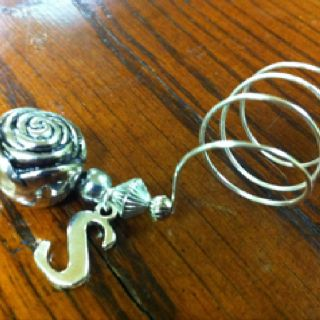 Silver coil wire Initial wine glass charms from LilyHill Vintage http://www.etsy.com/listing/86418269/silver-monogram-letter-or-initial-coil