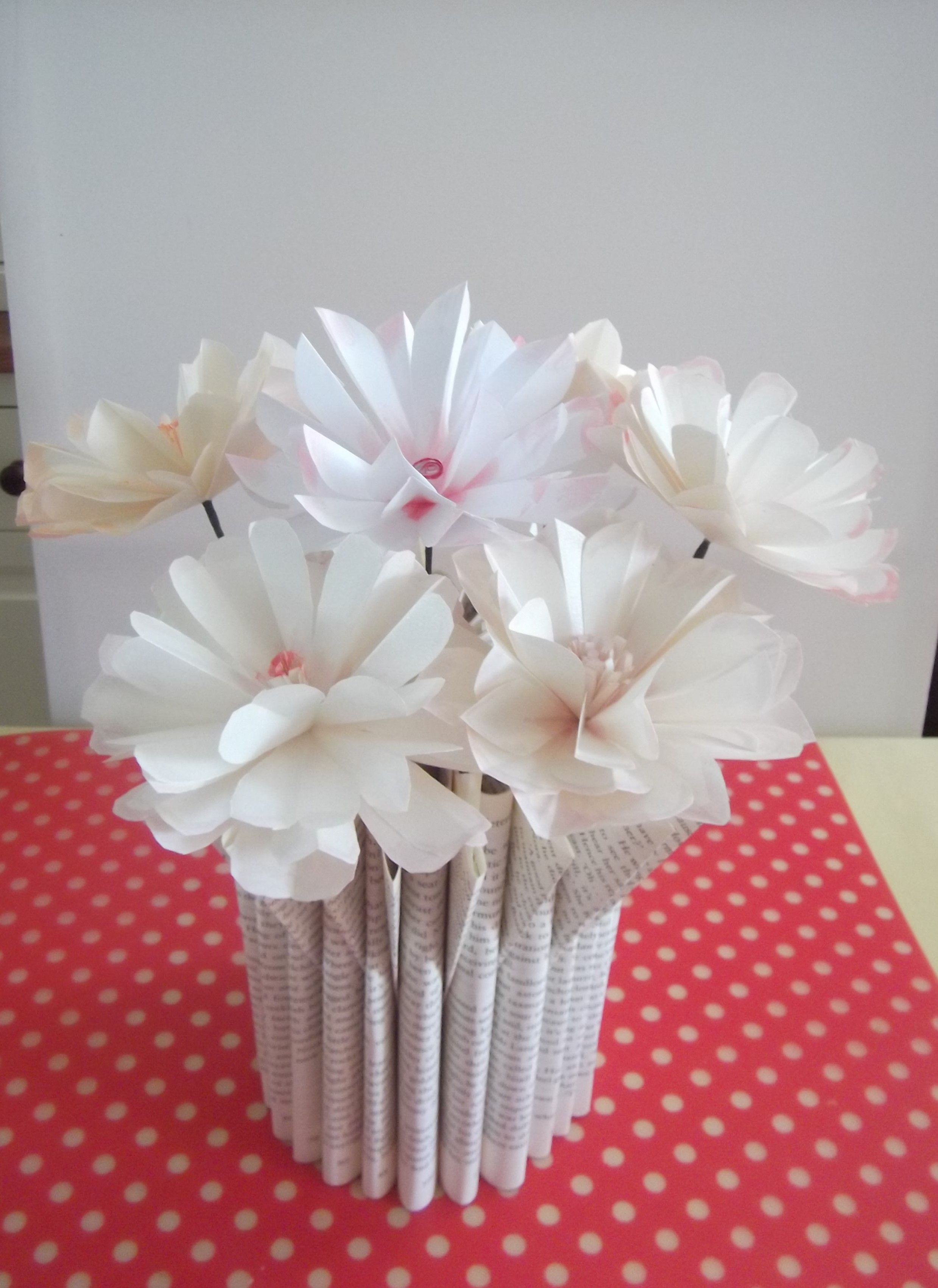 Paper Flowers Displayed In A Book Fold Vase