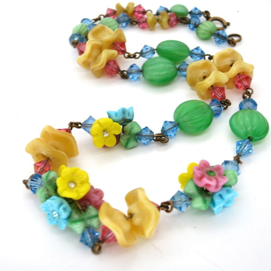 Have vintage glass flower beads
