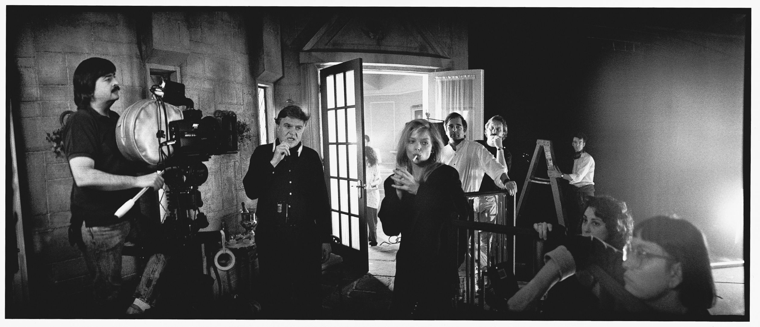 """Writer/director Steve Kloves, Michelle Pfeiffer, and Beau Bridges prepare a shot on the set of """"The Fabulous Baker Boys"""", 1989.  Photo credit: Jeff Bridges.    Since the late 1970s, Bridges has taken shots behind the scenes and between takes on all the movies he has done.  In 2006, he released a book called """"Pictures By Jeff Bridges"""" that became extremely rare and collectible."""