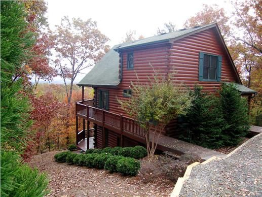 This tidy cabin is a favorite for weekenders. A bedroom and bath on each floor make it a great get-away for friends and couples. The upstairs bedroom is open to the two-story great room below. The basement or terrace level can be finished at a later date or used as storage.