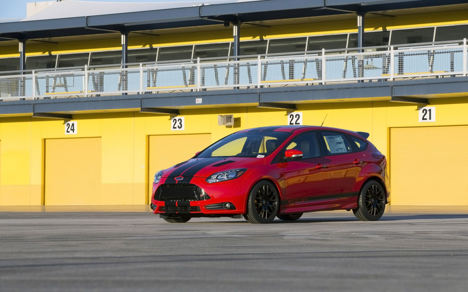 red ford focus st mk3 with black lines and rims