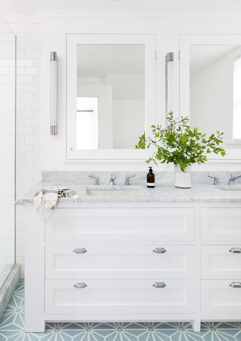 White bathroom with a pop of blue with fun ceramic tiles Madrona | Heidi Caillier