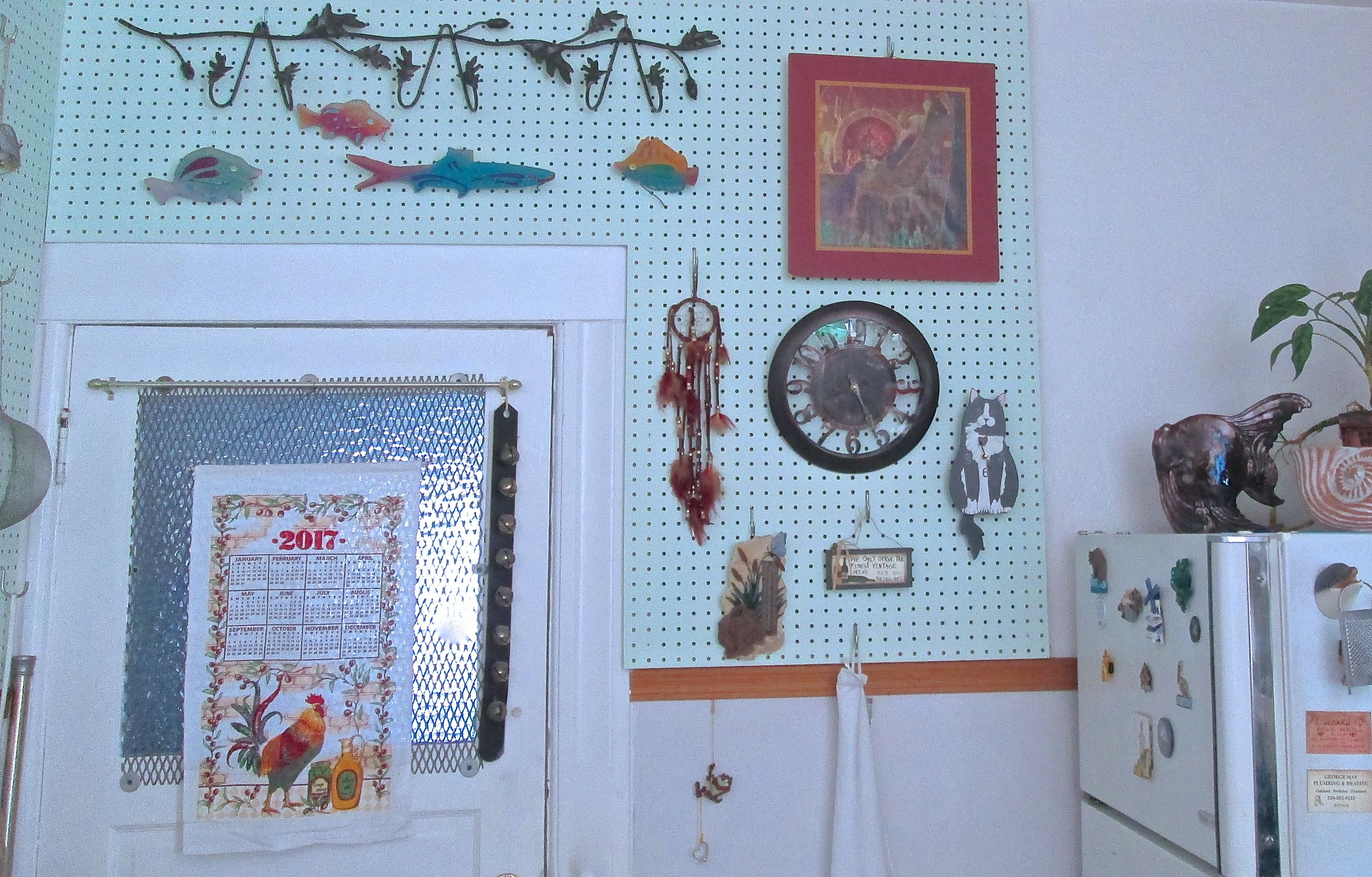 Pegboard covered kitchen walls. Great to hang kitchen tools, clock ...