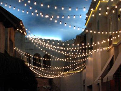 The white light glow pinterest lights patio lighting and patios another way to string market lights is just to string them randomly all going the same direction aloadofball Images