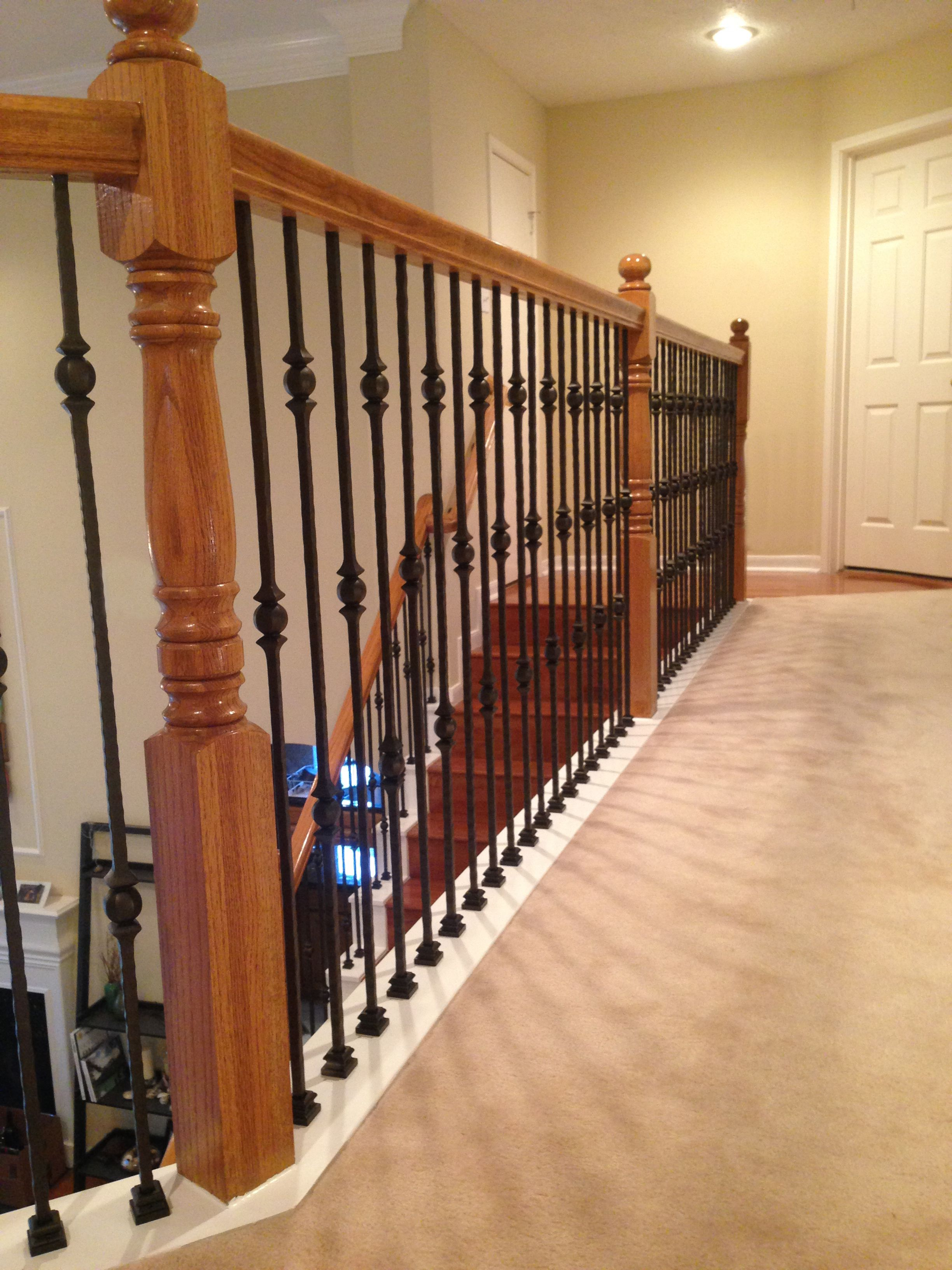At the Goodwin's Houston home we did a full baluster change out and added a wall rail to meet current building codes. Here you can see our PC18/1 and PC18/2 wrought iron balusters with a Dark Champagne finish.