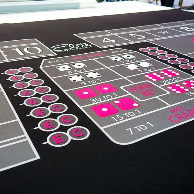 Black and hot pink custom Craps felt looks great! ♠️♥️♣️♦️ Wanna see more?  We sell tons of cool casino supplies online.  Link in our bio!