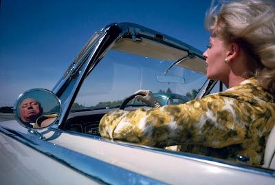 ALFRED HITCHCOCK AND TIPPI HEDREN DRIVING IN A CAR
