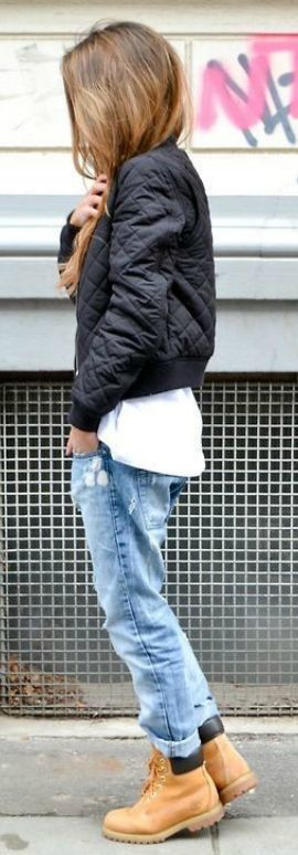 #fashion #outifits #winter Michelle Nielsen + Timberland boots + retro rolled jeans + cropped black bomber. Brands not specified.