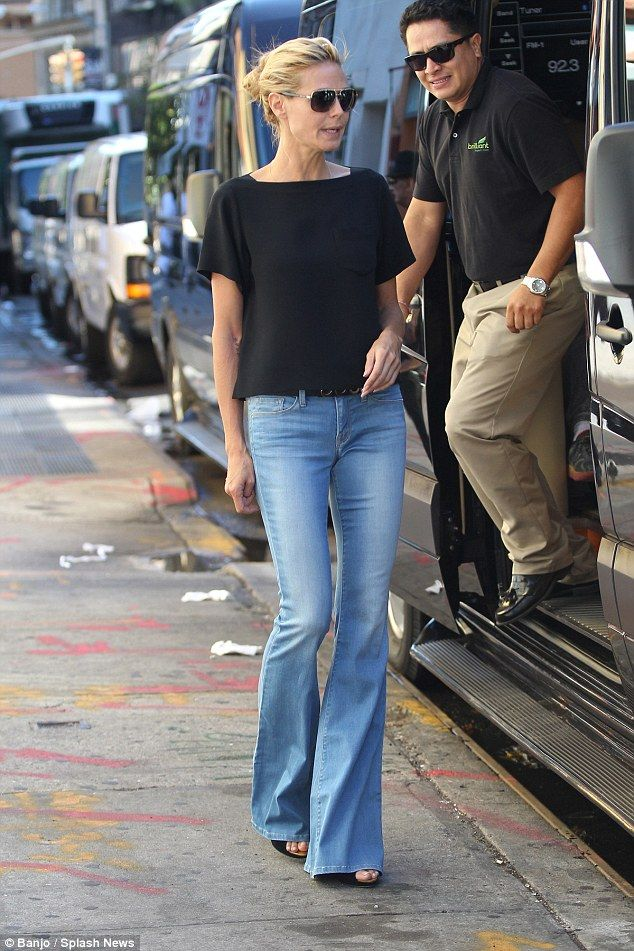 Heidi Klum displays her slender frame in retro flared jeans ...