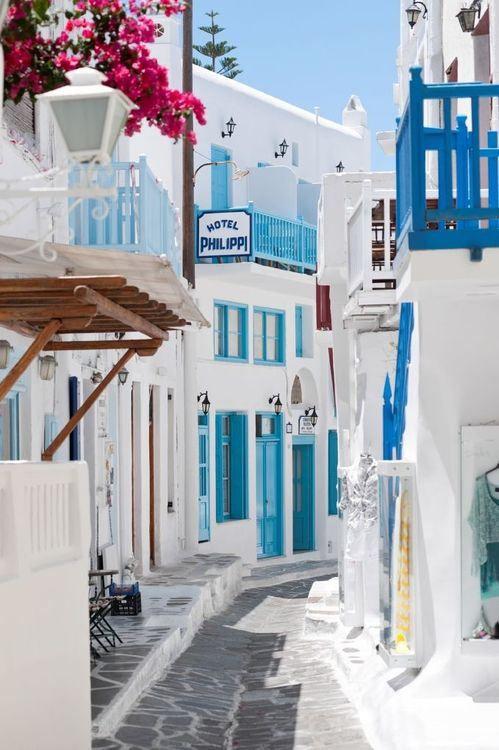 Pristine white buildings + Bougainvillea blossoms ~ Mykonos, Greece