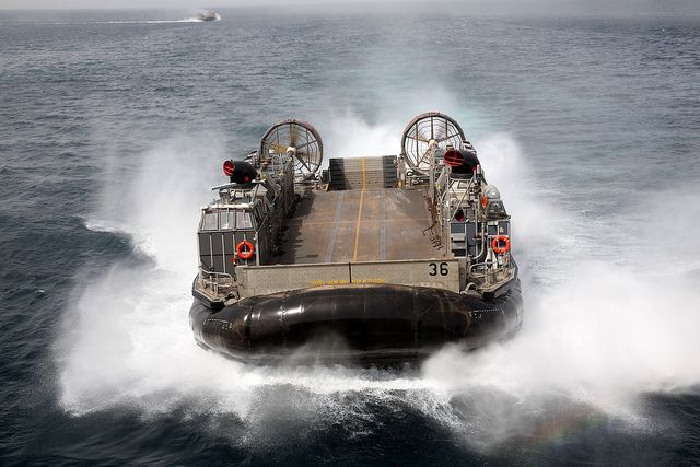 GULF OF ADEN (July 31, 2013) A landing craft air cushion from Assault Craft Unit Four (ACU 4) conducts operations near the amphibious assault ship USS Kearsarge (LHD 3). Kearsarge is the flagship for the Kearsarge Amphibious Ready Group and, with the embarked 26th Marine Expeditionary Unit, is deployed in support of maritime security operations and theater security cooperation efforts in the U.S. 5th Fleet area of responsibility. (U.S. Navy photo by Jonathan Vargas/Released)