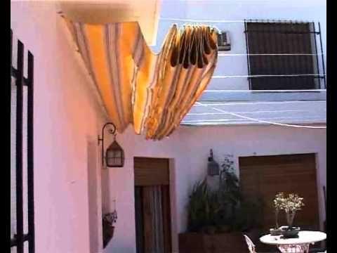 Toldo corredizo de patio fernando garutti en obras 14 11 for Tordos para patios