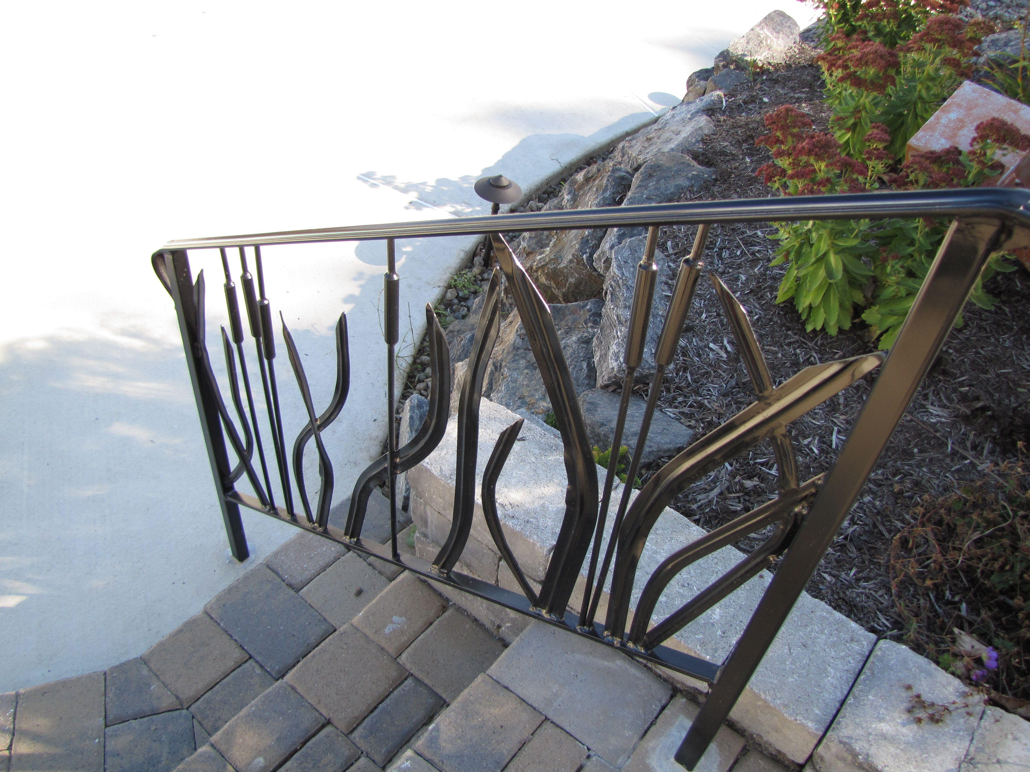 Custom railing with cat tails and reeds Custom railing