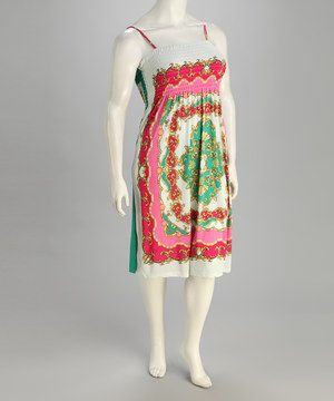 Equal Parts Exotic And Elegant This Pretty PrintAdorned Dress Is