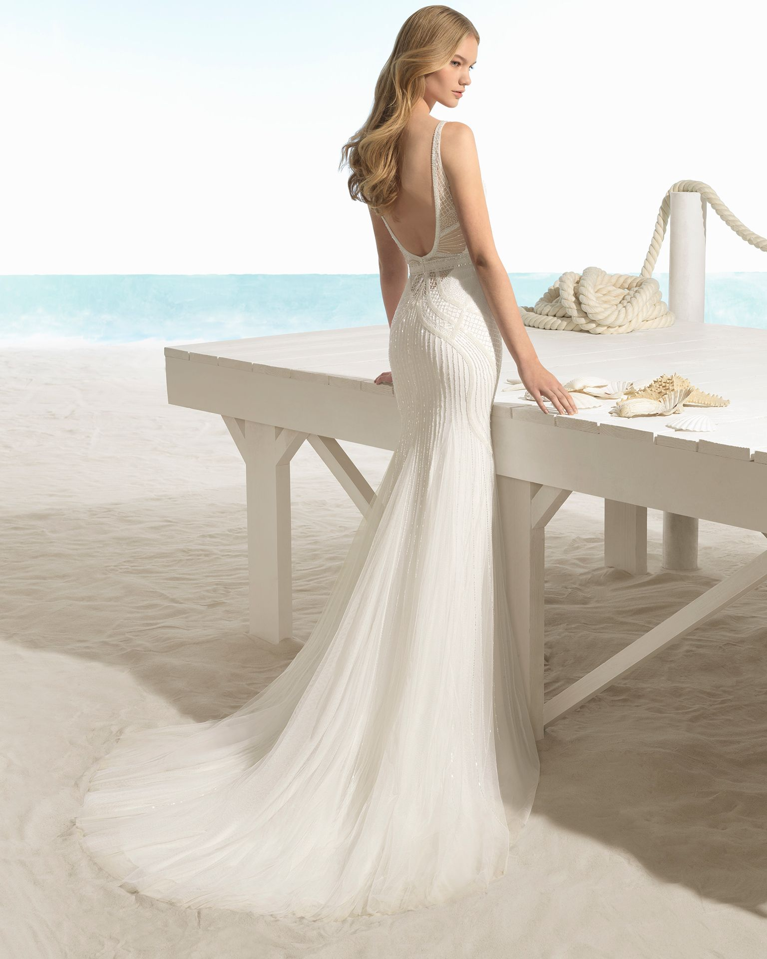 Bohostyle beaded wedding dress with sweetheart neckline and Vback