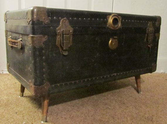 Wood peg legs affixed to a steamer trunk yes imagine Hairpin legs